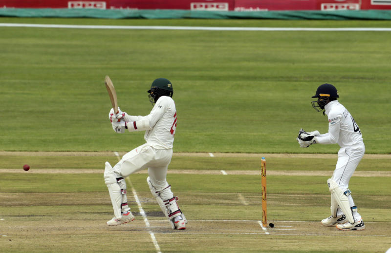 Zimbabwean batsman Donald Tiripano,left, plays a shot during the test match against Sri Lanka at Harare Sports Club, Monday, Jan,20, 2020. Zimbabwe is playing in its first international match since the International Cricket Council lifted the country's ban last year. (AP Photo/Tsvangirayi Mukwazhi)