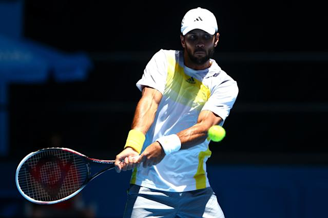 MELBOURNE, AUSTRALIA - JANUARY 14: Fernando Verdasco of Spain plays a backhand in his first round match against David Goffin of Belgium during day one of the 2013 Australian Open at Melbourne Park on January 14, 2013 in Melbourne, Australia. (Photo by Mark Kolbe/Getty Images)