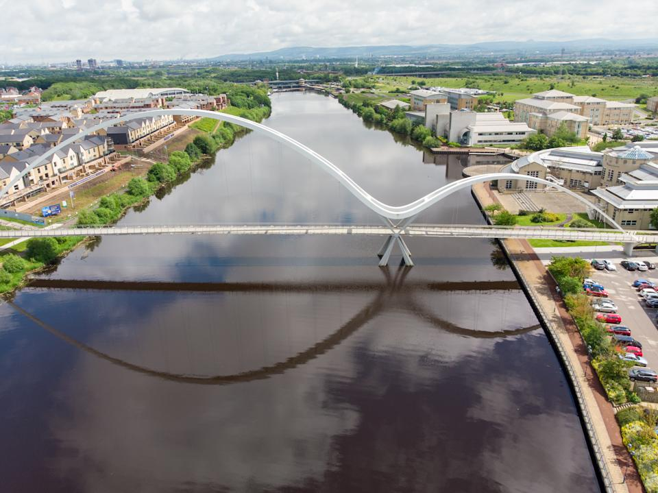 Aerial photo of The famous Infinity Bridge located in Stockton-on-Tees taken on a bright sunny part cloudy day.