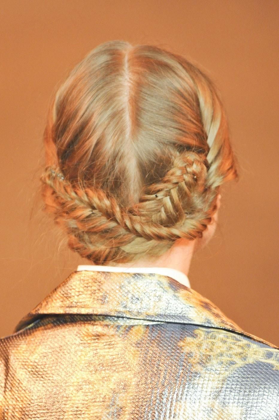 """<div class=""""caption-credit""""> Photo by: Stylecaster Pictures</div>For the Christian Siriano show, Antoinette Beenders for Aveda created an intricate fishtail braid updo. <br>"""