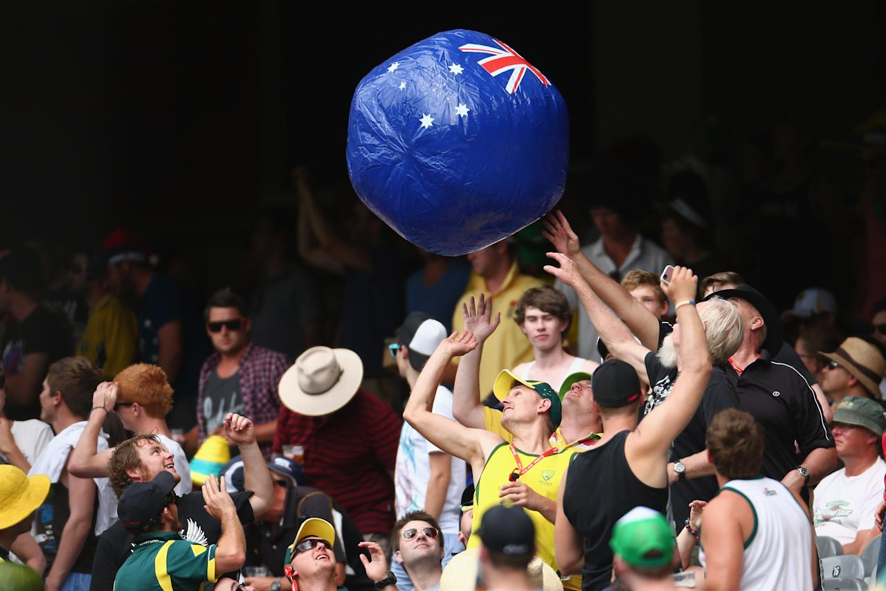 MELBOURNE, AUSTRALIA - DECEMBER 27: Fans play with a beach ball during day two of the Second Test match between Australia and Sri Lanka at Melbourne Cricket Ground on December 27, 2012 in Melbourne, Australia.  (Photo by Robert Cianflone/Getty Images)