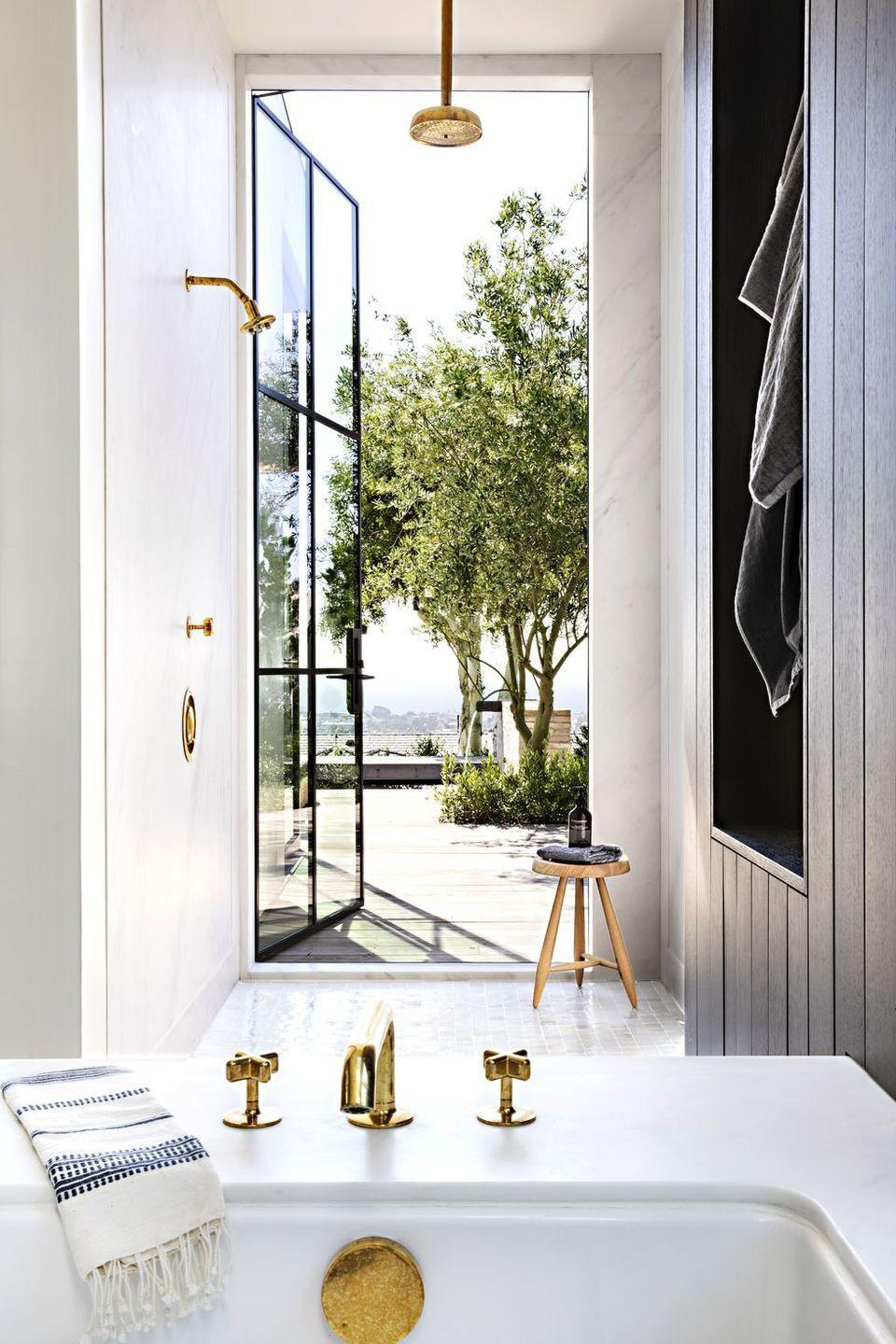 "<p>In the main bath of his California home, architect <a href=""https://www.housebeautiful.com/design-inspiration/house-tours/a28900705/eric-olsen-corona-del-mar-california-home/"" rel=""nofollow noopener"" target=""_blank"" data-ylk=""slk:Eric Olsen"" class=""link rapid-noclick-resp"">Eric Olsen</a> added a glass door that opens to the outside. If you live near the ocean or have a bathroom on the main level of your home, this would be a great way to open up the shower space and make it seem less stuffy.</p>"