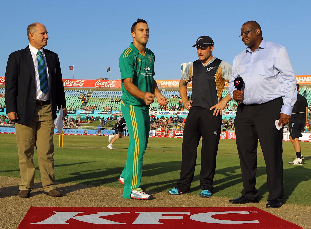 DURBAN, SOUTH AFRICA - DECEMBER 21:  Faf du Plessis of South Africa makes the toss ahead of the 1st T20 match between South Africa and New Zealand at Sahara Park Kingsmead on December 21, 2012 in Durban, South Africa.  (Photo by Anesh Debiky/Gallo Images/Getty Images)