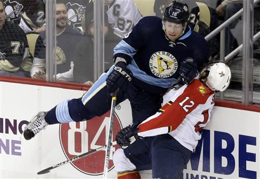 Pittsburgh Penguins left wing James Neal (18) checks Florida Panthers right wing Jack Skille (12) during the first period of an NHL hockey game in Pittsburgh on Friday, Feb. 22, 2013. (AP Photo/Gene J. Puskar)