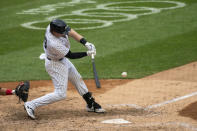 New York Yankees' Luke Voit hits a three-run home run in the sixth inning of a baseball game against the Miami Marlins at Yankee Stadium, Saturday, Sept. 26, 2020, in New York. (AP Photo/Corey Sipkin)