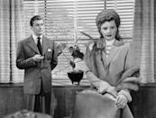 <p>In his first movie, Kirk Douglas played Walter O'Neil in <em>The Strange Love of Martha Ivers. </em>Here, he shoots a scene with his costar, Barbara Stanwyck. </p>