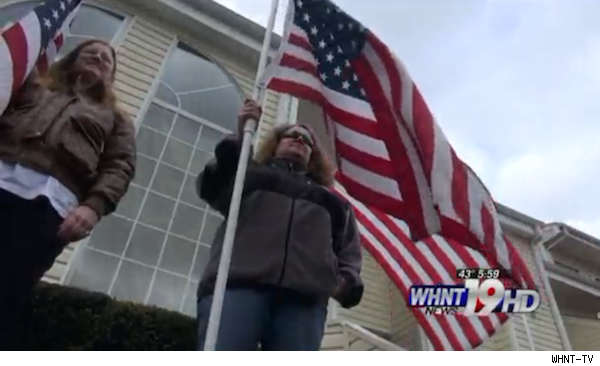Brandon Weir and his wife with American flags