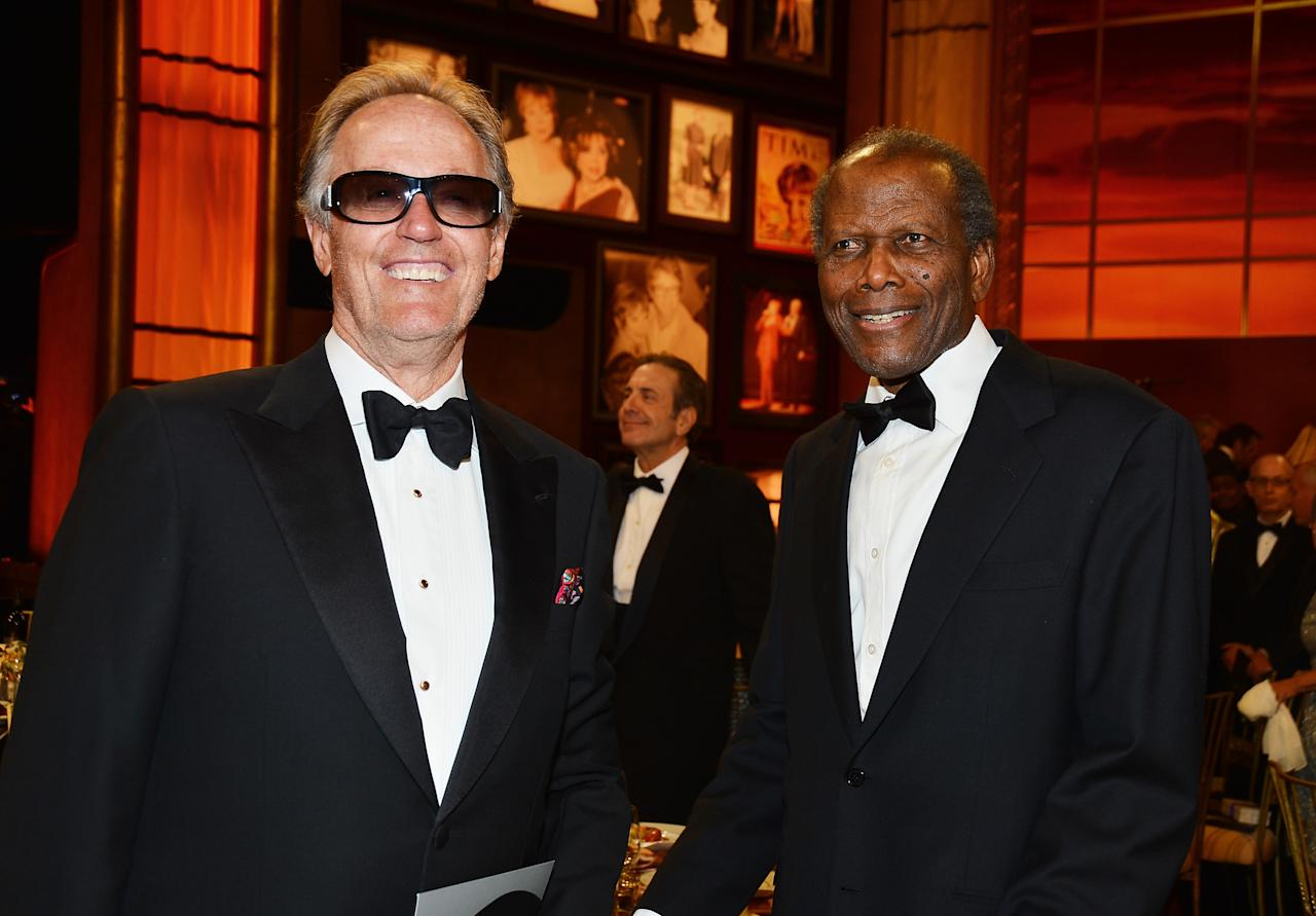 CULVER CITY, CA - JUNE 07:  Actors Peter Fonda (L) and Sydney Poitier attend the 40th AFI Life Achievement Award honoring Shirley MacLaine held at Sony Pictures Studios on June 7, 2012 in Culver City, California. The AFI Life Achievement Award tribute to Shirley MacLaine will premiere on TV Land on Saturday, June 24 at 9PM ET/PST.  (Photo by Frazer Harrison/Getty Images for AFI)