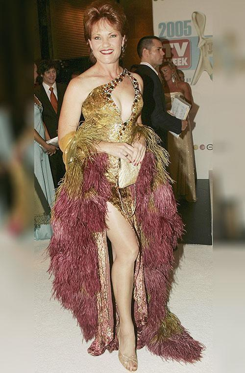 Outspoken politician Pauline Hanson's outfit to the 2005 awards screamed 'showgirl,'and showed off a whole lot more than we'd ever seen before. From the thigh-high split to the low-cut neckline and the mountains of gold and pink fringing, it was hard to know where to look. Pauline appears rather chuffed with the outfit but we reckon it's a little too costume-y for our liking. Photo: Getty Images.