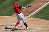 Cincinnati Reds' Joey Votto hits a two-run RBI double during the fifth inning of a baseball game against the Cleveland Indians in Cincinnati, Sunday, April 18, 2021. (AP Photo/Aaron Doster)