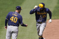 Milwaukee Brewers' Avisail Garcia (24) is congratulated by third base coach Jason Lane (40) after hitting a two-run home run during the fifth inning of a baseball game against the St. Louis Cardinals Saturday, April 10, 2021, in St. Louis. (AP Photo/Jeff Roberson)