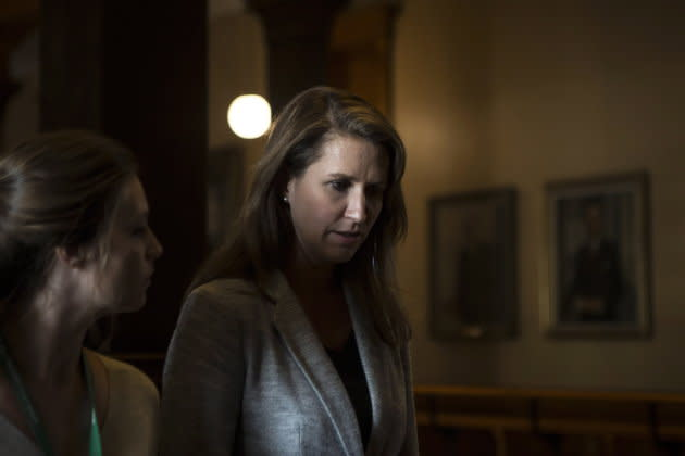 Caroline Mulroney walks away after scrumming with reporters after at the Ontario Legislature in Toronto, on Sept. 13, 2018.