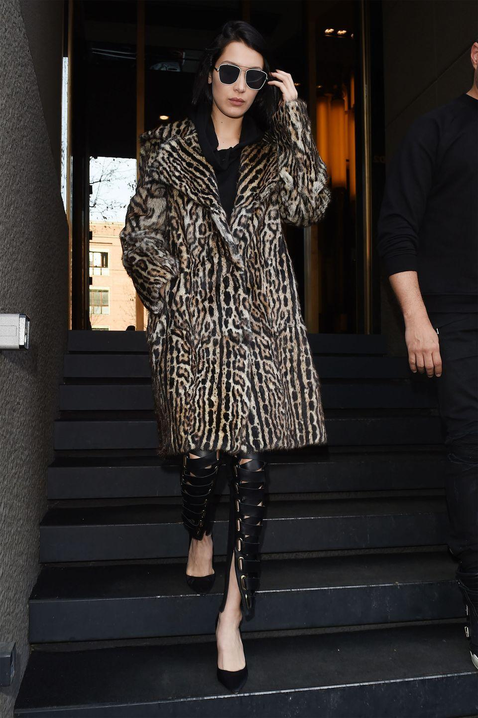 <p>In a leopard Lilly e Violetta coat, hoodie, lace-up leather pants, black pumps and Vera Wang aviator sunglasses while out in Milan.</p>