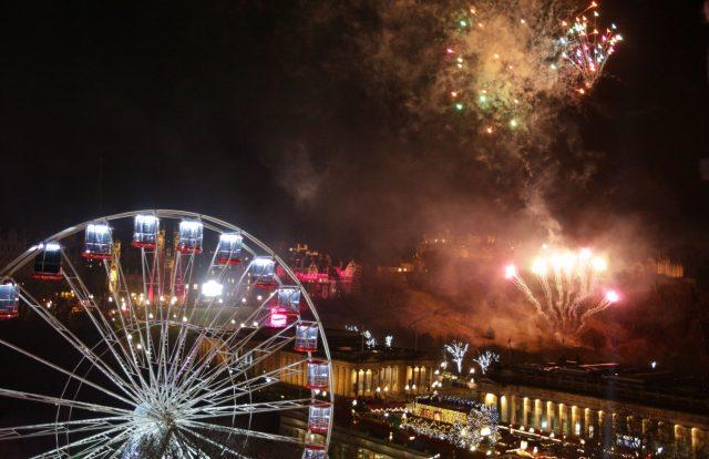 Fireworks light up the sky in Edinburgh during the Hogmanay New Year celebrations (David Cheskin/PA)