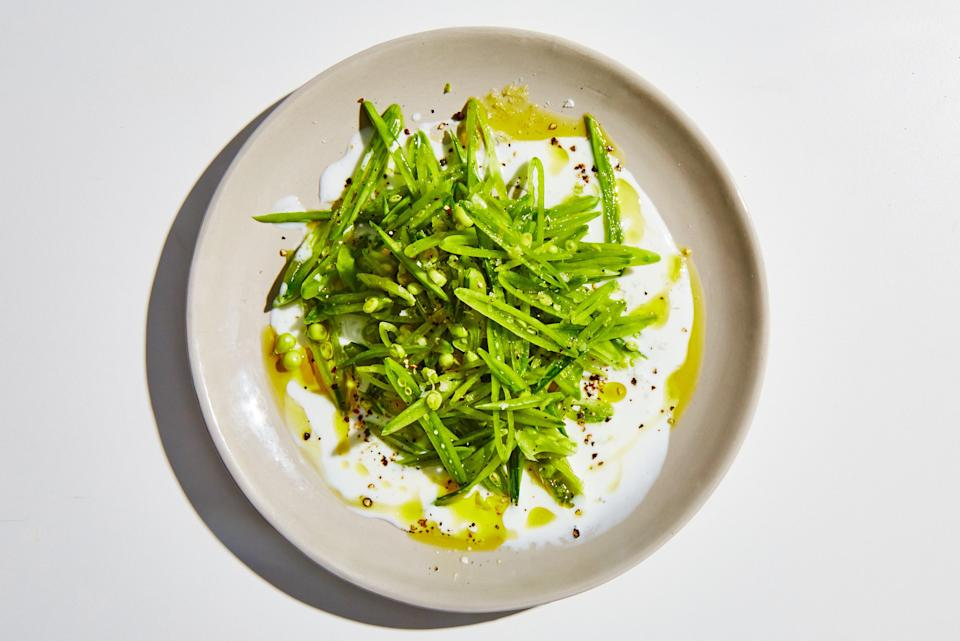 "Come springtime, sugar snap peas are so tender and fresh it's almost a shame to cook them. We prefer slicing them thinly and eating them raw with a simple dressing, like this creamy, tangy buttermilk one. If you can find them, use tender, first-of-the-year peas in this raw salad; they can get starchy and tough later in the season. <a href=""https://www.bonappetit.com/recipe/sugar-snap-pea-salad?mbid=synd_yahoo_rss"" rel=""nofollow noopener"" target=""_blank"" data-ylk=""slk:See recipe."" class=""link rapid-noclick-resp"">See recipe.</a>"