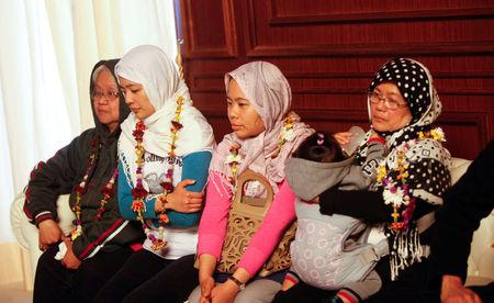 Filipino nurses, who were freed from Islamic State militants by Libyan forces in Sirte, sit together during a handover ceremony in the presence of a Filipino envoy in Tripoli, Libya, February 27, 2017. REUTERS/Ismail Zitouny