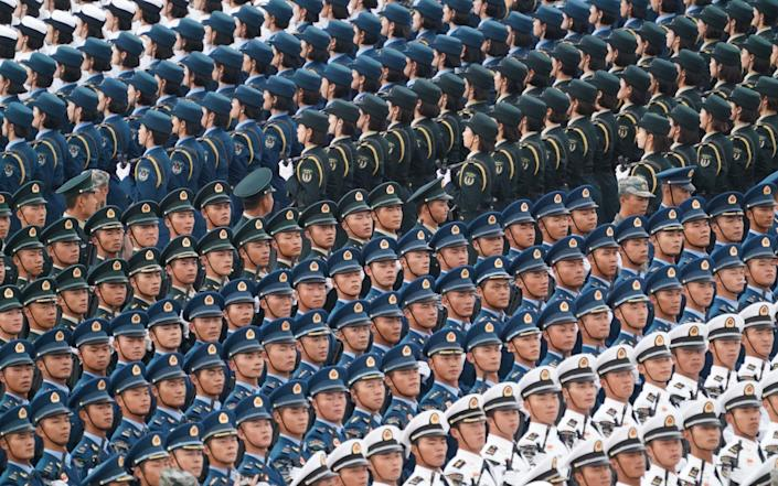Chinese soldiers take part in parade training for the upcoming National Day celebrations in Beijing - Xinhua / Barcroft Media