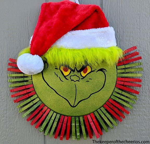 "<p>Welcome visitors to your home with the Grinch's wry smile. Pretty much all you need is a pizza pan and some clothespins to put together this whimsical wreath. </p><p><strong>Get the tutorial at <a href=""https://www.thekeeperofthecheerios.com/2018/10/grinch-clothespin-pizza-pan-wreath.html"" rel=""nofollow noopener"" target=""_blank"" data-ylk=""slk:The Keeper of the Cheerios"" class=""link rapid-noclick-resp"">The Keeper of the Cheerios</a>.</strong></p><p><strong><a class=""link rapid-noclick-resp"" href=""https://www.amazon.com/Home-X-Wooden-Clothespins-Set-50/dp/B00WNFZH30/ref=sr_1_3_sspa?crid=3I9PTIGYV2CQY&dchild=1&keywords=clothes+pins+for+hanging+clothes&qid=1603062585&sprefix=CLOTHES+PINS%2Caps%2C962&sr=8-3-spons&psc=1&spLa=ZW5jcnlwdGVkUXVhbGlmaWVyPUEyVUFJU1Q4WkY0TktVJmVuY3J5cHRlZElkPUEwNDI3NjI1M05OUzQwREdFTkJPRiZlbmNyeXB0ZWRBZElkPUEwMTAwNjMySEZIM09UVzFPUDFWJndpZGdldE5hbWU9c3BfYXRmJmFjdGlvbj1jbGlja1JlZGlyZWN0JmRvTm90TG9nQ2xpY2s9dHJ1ZQ%3D%3D&tag=syn-yahoo-20&ascsubtag=%5Bartid%7C10050.g.28982778%5Bsrc%7Cyahoo-us"" rel=""nofollow noopener"" target=""_blank"" data-ylk=""slk:SHOP CLOTHES PINS"">SHOP CLOTHES PINS</a><br></strong></p>"