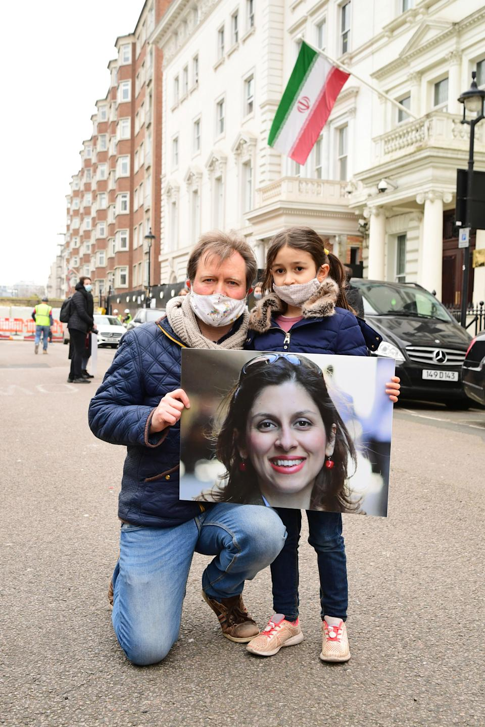 Richard Ratcliffe, the husband of Nazanin Zaghari-Ratcliffe, with his daughter Gabriella during a protest outside the Iranian Embassy in London (Photo: PA)