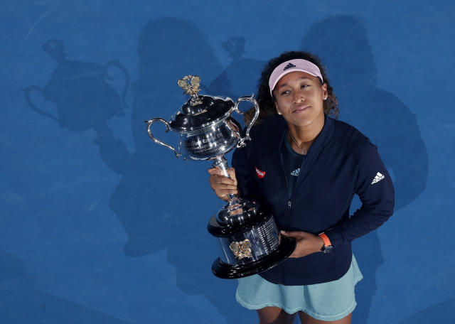 File-This Jan. 26, 2019, file photo shows Japan's Naomi Osaka holding her trophy after defeating Petra Kvitova of the Czech Republic during the women's singles final at the Australian Open tennis championships in Melbourne, Australia. Osaka sure looks here to stay. Australia makes her resume. (AP Photo/Kin Cheung, File)