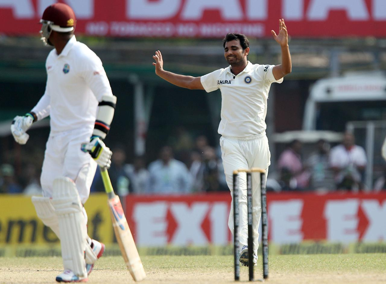 MOhammed Shami celebrates the wicket of Marlon Samuels of West Indies  during day three of the first Star Sports test match between India and The West Indies held at The Eden Gardens Stadium in Kolkata, India on the 8th November 2013  Photo by: Ron Gaunt - BCCI - SPORTZPICS