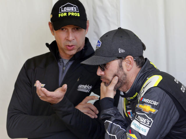 FILE - In this Friday, April 20, 2018, file photo, Jimmie Johnson, right, listens to crew chief Chad Knaus, as they wait for their car to get through inspection prior to qualifying for the NASCAR Cup Series auto race at Richmond Raceway in Richmond, Va. There will be no eighth NASCAR title for Johnson and Knaus. Hendrick Motorsports will split the driver and crew chief at the end of this season, the team announced Wednesday, Oct. 10, 2018. (AP Photo/Steve Helber, FIle)