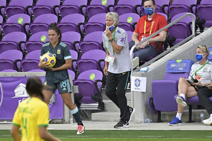 Brazil head coach Pia Sundhage, center, calls out instructions during the first half of a SheBelieves Cup women's soccer match against Argentina, Thursday, Feb. 18, 2021, in Orlando, Fla. (AP Photo/Phelan M. Ebenhack)