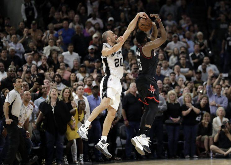 Manu Ginobili blocks James Harden's shot, sealing Game 5 for the Spurs. (AP)