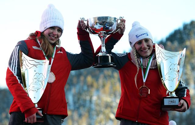 ST MORITZ, SWITZERLAND - JANUARY 26: Kaillie Humphries and Chelsea Valois of Canada celebrates with the medals after the Women's Bobsleigh final heat of the IBSF Bob & Skeleton World Championship at Olympia Bob Run on January 26, 2013 in St Moritz, Switzerland. (Photo by Lars Baron/Bongarts/Getty Images)