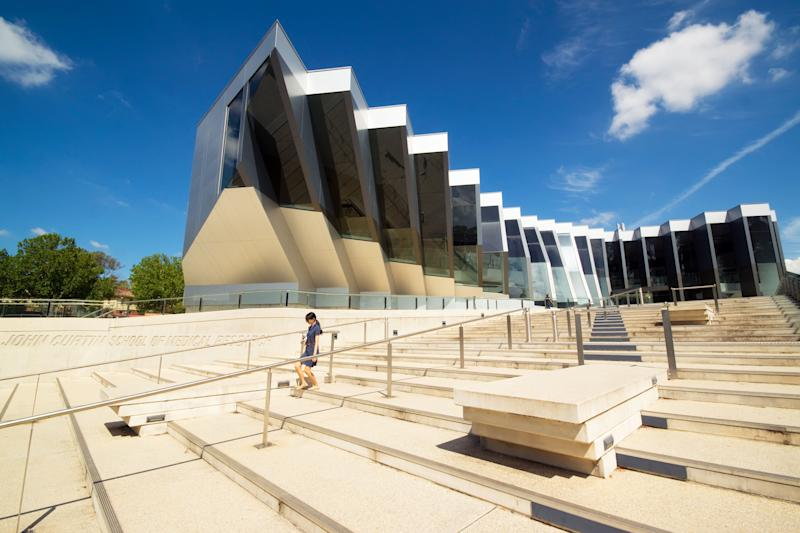 A woman walks down steps before the John Curtin School of Medical Research at the Australian National University. (Photo: kokkai via Getty Images)
