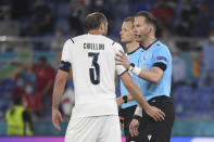 Italy's Giorgio Chiellini, left speaks with referee Danny Makkelie during the Euro 2020 soccer championship group A match between Italy and Turkey at the Olympic stadium in Rome, Friday, June 11, 2021. (Alberto Lingria/Pool Photo via AP)