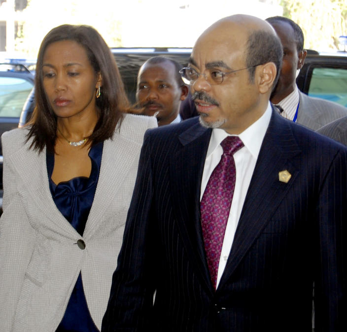 FILE - In this Jan. 30, 2011 file photo, Ethiopian Prime Minister Meles Zenawi, right, with first lady Azeb Mesfin, arrives at African Union summit in Addis Ababa, Ethiopia. Meles died Monday, Aug. 20, 2012 following weeks of illness, Ethiopian State media reported. He was 57. (AP Photo/Samson Haileyesus, File)