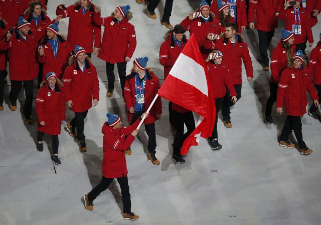Austria's flag-bearer Mario Stecher leads his country's contingent during the opening ceremony of the 2014 Sochi Winter Olympics, February 7, 2014. REUTERS/Lucy Nicholson (RUSSIA - Tags: OLYMPICS SPORT)