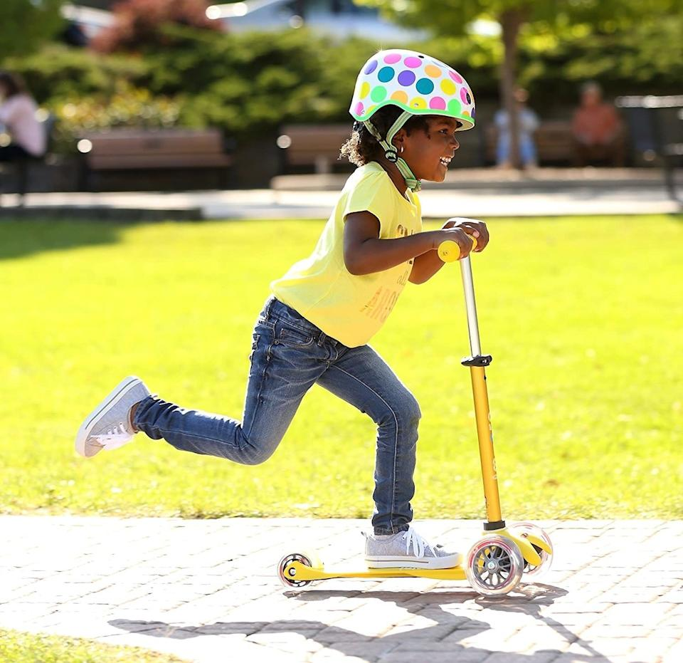 """With an adjustable handlebar to grow with your toddler, this toy will be there as they improve their balance and motor skills. Also, it includes a two-year warranty.<br /><br /><strong>Promising review:</strong>""""Best scooter ever! It's an easy assembly. It's a smooth ride and the perfect size for a 2-year-old. Spend more money and go with the deluxe model especially if your child is only 2. I brought this to the park today and two more of my mommy friends went home and bought their kids these today too! They come in the most beautiful colors.<strong>Kids are not really taught how to use these, they seem to just get on them and go!</strong>It was amazing to see my 2-year-old-take off like a champ!"""" —<a href=""""https://amzn.to/3tJ0GMZ"""" target=""""_blank"""" rel=""""noopener noreferrer"""">TexSpaceman12</a><br /><strong><br />Get it from Amazon for<a href=""""https://amzn.to/2QJr4Yq"""" target=""""_blank"""" rel=""""noopener noreferrer"""">$89.99</a>(available in 12 colors).</strong>"""