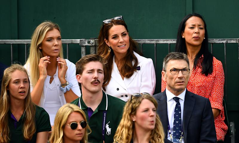 The Duchess of Cambridge with Katie Boulter (left) and Anne Keothavong (right) as they watch Harriet Dart in action on day two of the Wimbledon Championships at the All England Lawn Tennis and Croquet Club, Wimbledon. (Photo by Victoria Jones/PA Images via Getty Images)