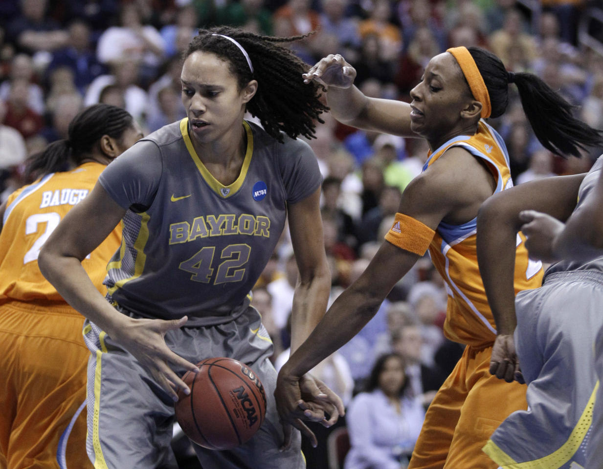 Baylor's Brittney Griner grabs a rebound in front of Tennessee's Glory Johnson during the first half of an NCAA women's college basketball tournament regional final, Monday, March 26, 2012, in Des Moines, Iowa. (AP Photo/Charlie Neibergall)