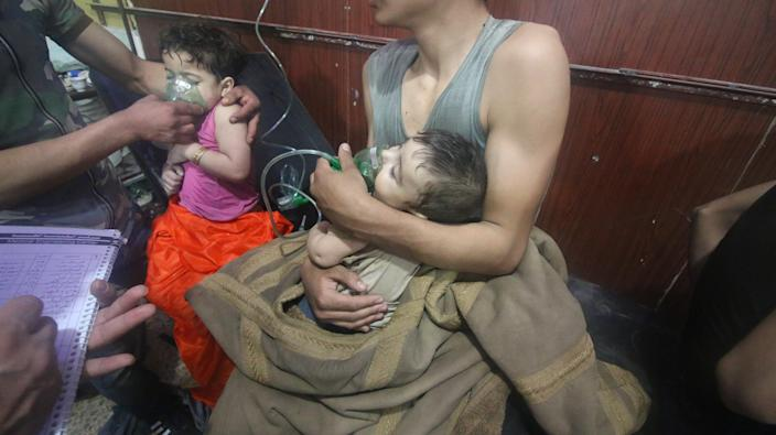 A Syrian child receives medical treatment after the Assad regime forces allegedly conducted a poisonous gas attack in Damascus