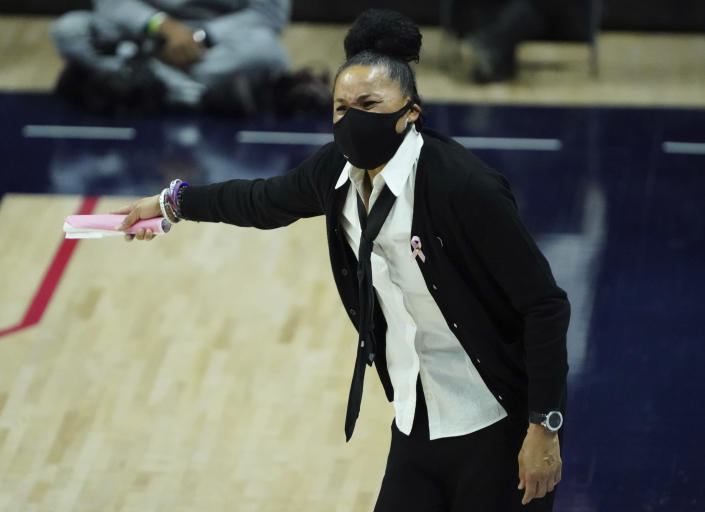 South Carolina head coach Dawn Staley watches from the sideline as her players take on Connecticut in overtime of an NCAA college basketball game in Storrs, Conn., Monday, Feb. 8, 2021. (David Butler/Pool Photo via AP)