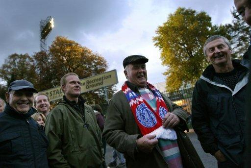 Aldershot Town fans queue outside the turnstiles ahead of their clash with Manchester United. United shrugged off their mauling against Manchester City to book their place in the quarter-finals of the League Cup with a comfortable 3-0 win over Aldershot