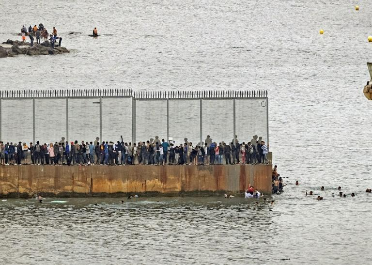 Thousands of Moroccan migrants swam or used inflatable boats to get around Ceuta's border fence