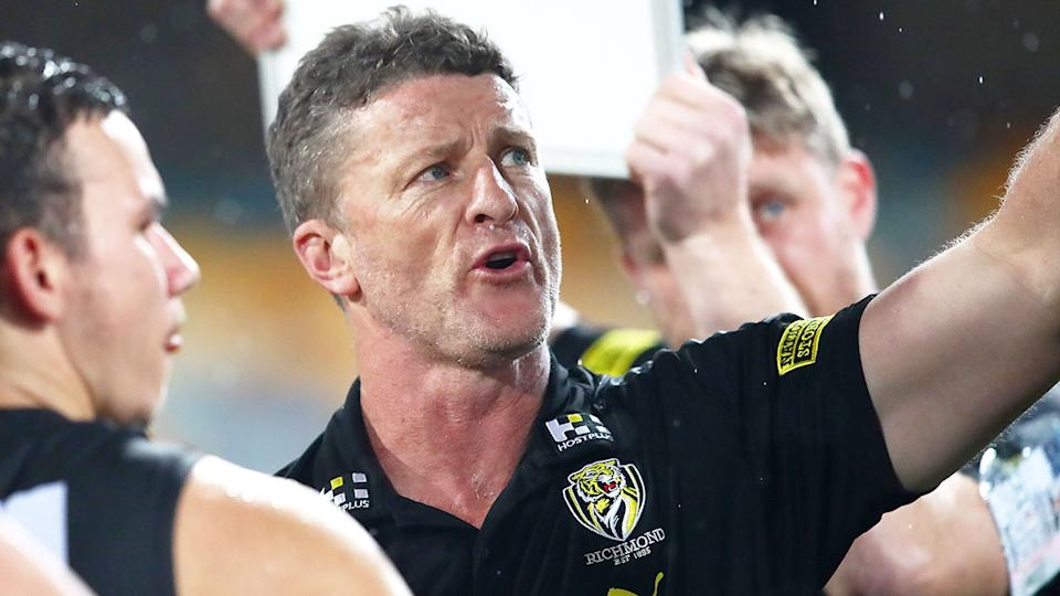 Pictured here, Richmond coach Damien Hardwick addressing his players.