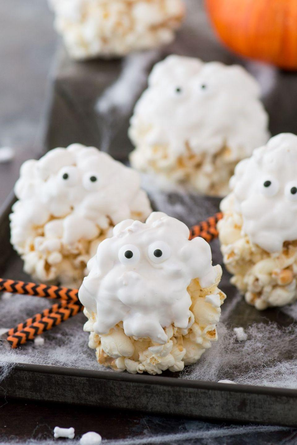 """<p>Got white candy melts, some popcorn, and marshmallows? Then you're halfway to this hilarious-looking dessert, which will delight kids and grownups alike.</p><p><strong>Get the recipe at <a href=""""https://thefirstyearblog.com/ghost-popcorn-balls/"""" rel=""""nofollow noopener"""" target=""""_blank"""" data-ylk=""""slk:The First Year"""" class=""""link rapid-noclick-resp"""">The First Year</a>.</strong></p><p><strong><a class=""""link rapid-noclick-resp"""" href=""""https://go.redirectingat.com?id=74968X1596630&url=https%3A%2F%2Fwww.walmart.com%2Fip%2FThe-Pioneer-Woman-Spring-10-Piece-Baking-Prep-Set-Teal%2F269954471&sref=https%3A%2F%2Fwww.thepioneerwoman.com%2Ffood-cooking%2Fmeals-menus%2Fg32110899%2Fbest-halloween-desserts%2F"""" rel=""""nofollow noopener"""" target=""""_blank"""" data-ylk=""""slk:SHOP BAKING TOOLS"""">SHOP BAKING TOOLS</a><br></strong></p>"""