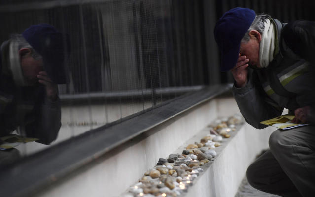 <p>A man prays at the Victims' Memorial Wall bearing names of victims during a commemoration marking the International Holocaust Remembrance Day in the Holocaust Memorial Centre in Budapest, Hungary, Friday, Jan. 26, 2018, on the eve of the actual day.(Photo: Tibor Illyes/MTI via AP) </p>