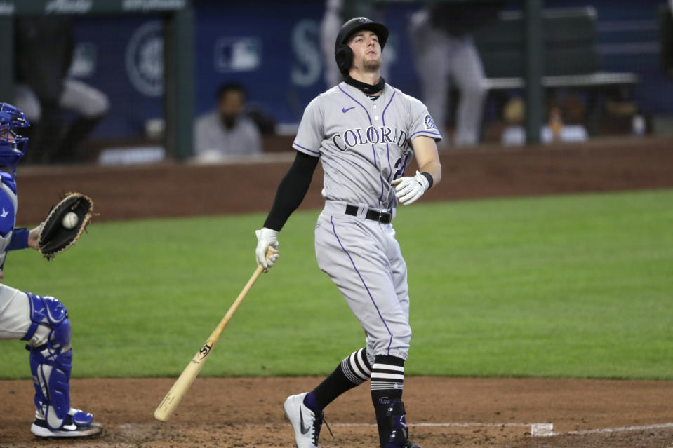 Colorado Rockies' Ryan McMahon spins around after striking out to end the top of the fourth inning of a baseball game against the Seattle Mariners, Sunday, Aug. 9, 2020, in Seattle. (AP Photo/Elaine Thompson)