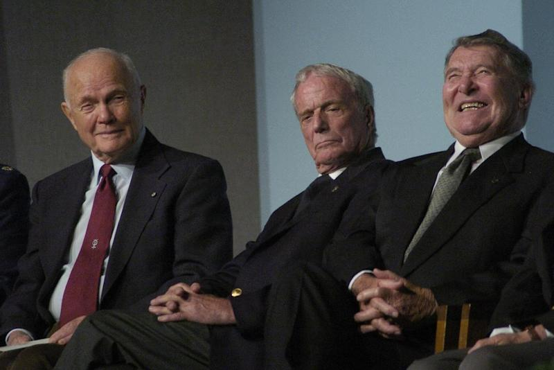 FILE - In this Oct. 15, 2004 file photo, former astronauts John Glenn, Scott Carpenter and Wally Schirra attend a memorial for their former Project Mercury teammate, Leroy Gordon Cooper, at a memorial service at the Johnson Space Center for Cooper, the fourth of the original 7 astronauts to die. Carpenter's death on Oct. 10, 2013 leaves Glenn as the sole living member of the famed group. Schirra died in 2007. (AP Photo/Houston Chronicle, Steve Ueckert, File)