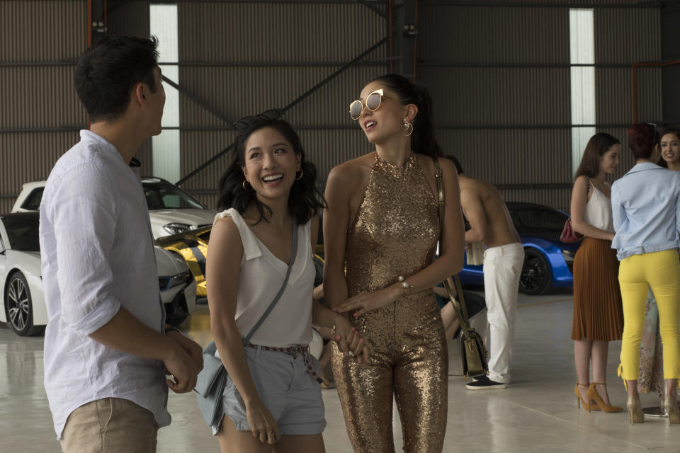 """Constance Wu (middle) with Henry Golding and Sonoya Mizuno in a scene from """"Crazy Rich Asians"""". PHOTO: Warners Bros Singapore"""