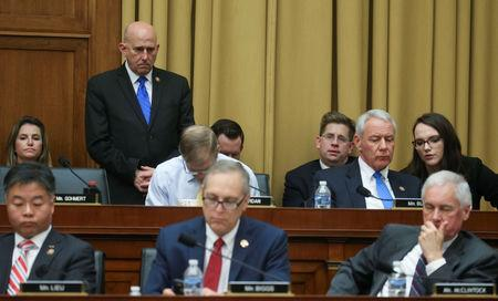 U.S. Rep. Louie Gohmert (R-TX) stands behind colleagues Rep. Jim Jordan (R-OH) and Rep. Ken Buck (R-CO) in the back row and Rep. Ted Lieu (D-CA), Rep. Ted Biggs (R-AZ) and Rep. Tom McClintock (R-CA) in the front row as the House Judiciary Committee debates whether U.S. Attorney General William Barr should be held in contempt over his refusal to comply with a subpoena seeking an unredacted version of the Mueller report on Capitol Hill in Washington, U.S., May 8, 2019. REUTERS/Leah Millis