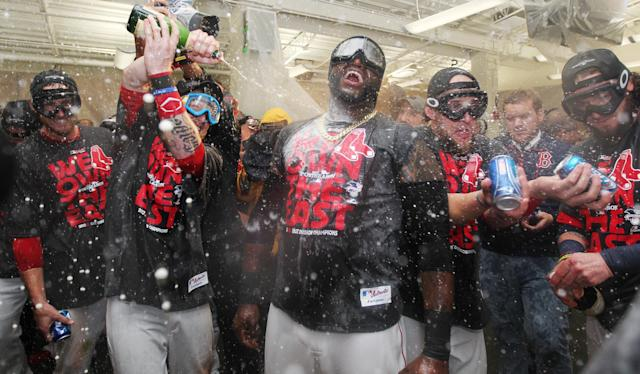 Boston Red Sox players celebrate after clinching the AL East with a 6-3 win over the Toronto Blue Jays in a baseball game at Fenway Park, Friday, Sept. 20, 2013, in Boston. (AP Photo/Charles Krupa)