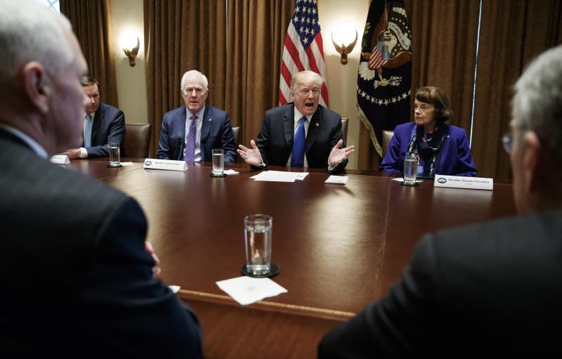 "FILE - In this Feb. 28, 2018, file photo, President Donald Trump speaks in the Cabinet Room of the White House, in Washington, during a meeting with members of congress to discuss school and community safety. With the president from left, Vice President Mike Pence, Sen. Chris Murphy, D-Conn., Sen. John Cornyn, R-Texas,, the president, Sen. Dianne Feinstein, D-Calif., and Sen. Chuck Grassley, R-Iowa. Not two weeks ago, Trump scolded a Republican senator for being ""afraid of the NRA"" and declared that he would stand up to the powerful gun lobby and finally get results on quelling gun violence. Now Trump is striking a very different tone as he backpedals from his earlier demands for sweeping reforms.(AP Photo/Carolyn Kaster, File)"