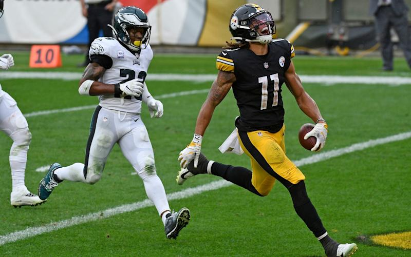 Pittsburgh Steelers wide receiver Chase Claypool (11) scores his fourth touchdown of an NFL football game, with Philadelphia Eagles free safety Rodney McLeod (23) defending, on a 35-yard pass play from quarterback Ben Roethlisberger during the second half in Pittsburgh, Sunday, Oct. 11, 2020. - AP